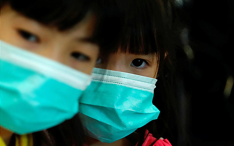 little-girl-china-mask-reuters